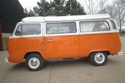 1976 RHD VW camper, Taken 2-4-10  Painted in Lecht orange with pastel white top half and pop top. Full G'day warander package