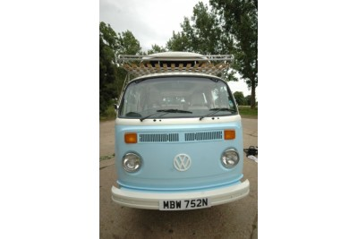 Guinea blue & pastel white bus supplied fully revamped by us in house